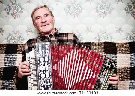 Elderly man playing on a musical instrument