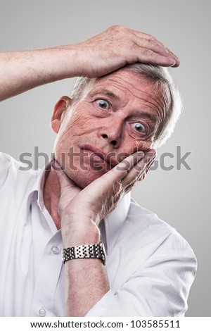 Elderly man puts his head in place