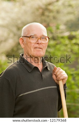 Elderly man relaxing after work in garden
