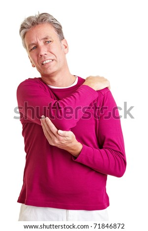 Elderly man with back pain holding his aching shoulder