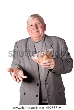Elderly man with money in hands. It is isolated on a white background