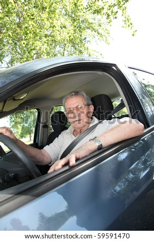 Elderly person driving a car