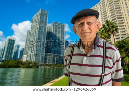 Elderly 80 plus year old man outdoor portrait in a downtown urban setting.