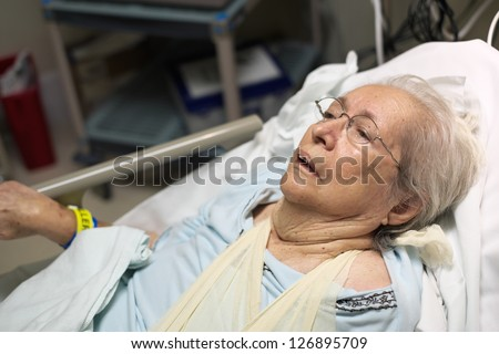 Elderly 80 plus year old woman in a hospital bed.