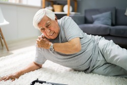 Elderly Senior Man Slip And Fall. Fallen Old Person