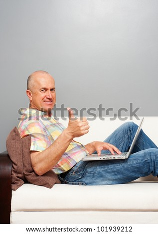 elderly smiley man with notebook showing thumbs up