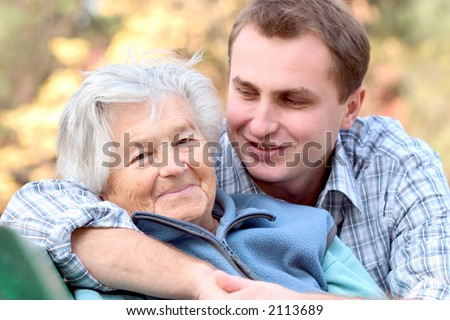 Elderly woman and her grandson. Focus on the woman.