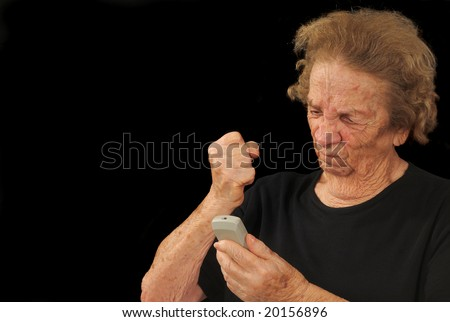 Elderly woman angered by a recalcitrant electronic device