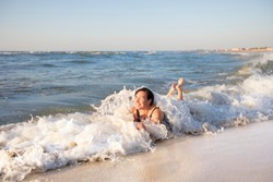 Elderly woman at the sea. Man on vacation at the beach.Portrait of a senior woman bathing in the sea