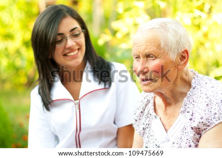 Elderly woman chatting with the doctor / nurse.