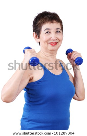 Elderly woman exercising with dumbbell.