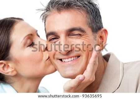 Elderly woman in love kissing happy man on cheek