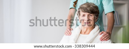 Elderly woman in nursing home and nurse