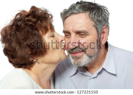 Elderly woman kisses her husband