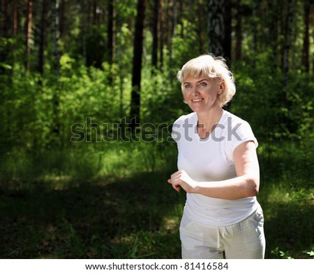 Elderly woman likes to run in the park. Healthy lifestyle