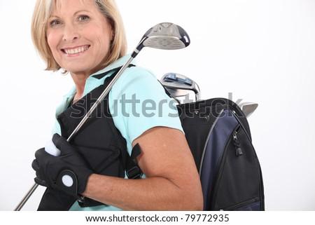elderly woman liking golf - stock photo