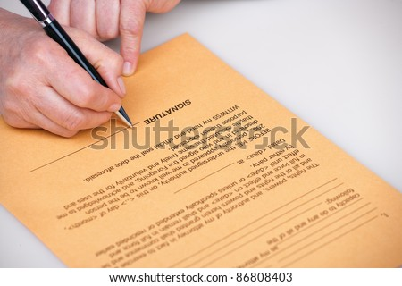 elderly woman signing testament on old paper