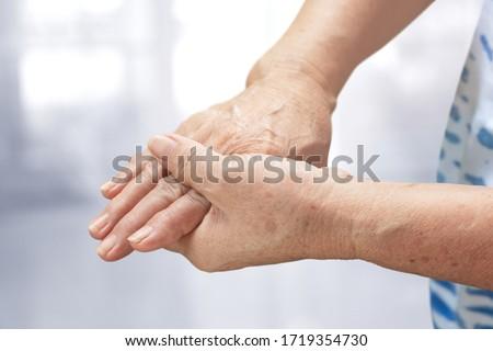 Elderly woman suffering from Beriberi pain or Peripheral neuropathiesj, Health care concept Stock photo ©