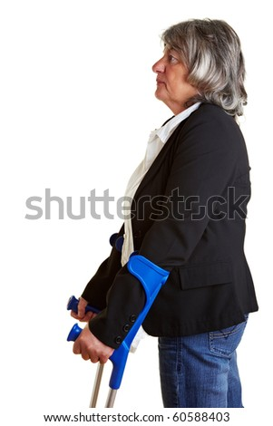 Elderly woman trying to walk with two crutches