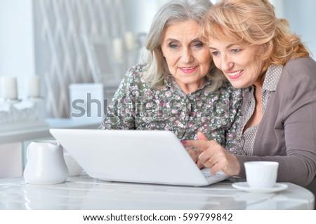 Elderly woman using a laptop #599799842