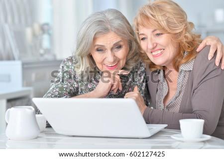 Elderly woman using a laptop #602127425