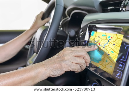 Elderly woman using GPS navigation system in car  #523980913