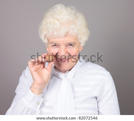 elderly woman with a nut