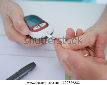 Elderly woman with blood testing in hospital.