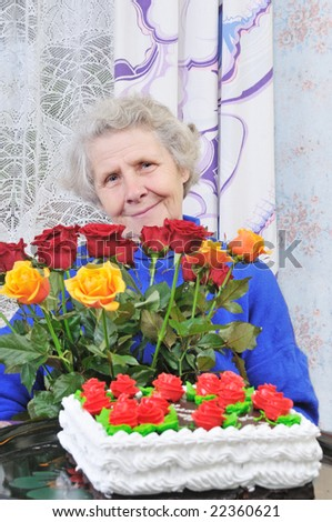 elderly woman with bouquet roses