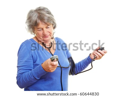 Elderly woman with gray hair measuring her blood pressure