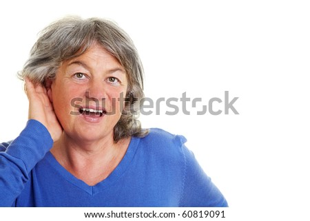 Elderly woman with hardness of hearing listening - stock photo