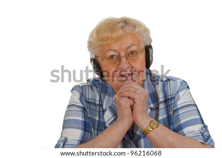 Elderly woman with headphones - isolated on white background