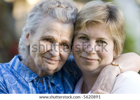 elderly woman with her daughter