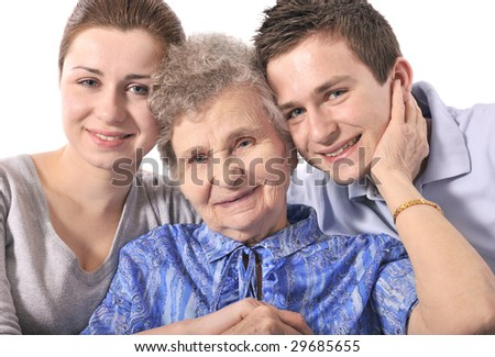 Elderly woman with her grandchildren
