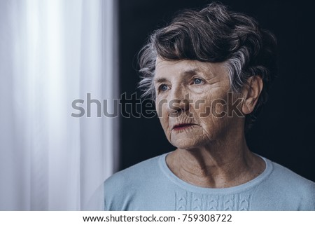 Elderly woman with memory problem spending time in nursing home