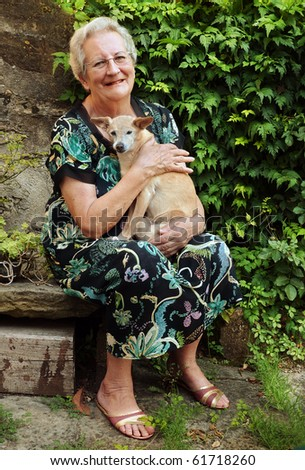 Elderly woman with pet dog