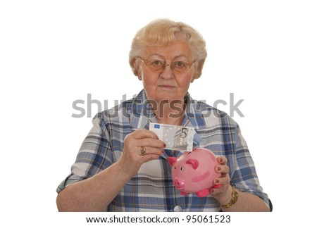 Elderly woman with piggy bank saving money - isolated on white background