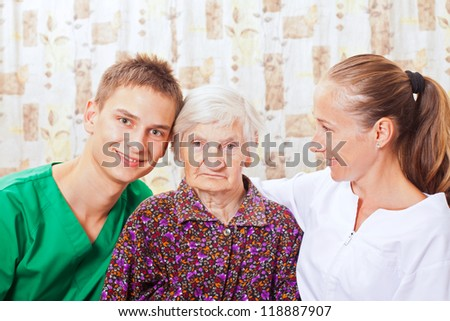 Elderly woman with the sweet young doctors
