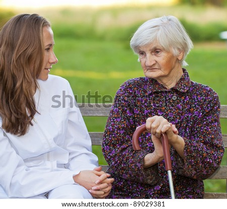 Elderly woman with the young sweet doctor