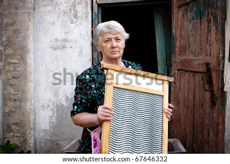 Elderly woman with washboard.