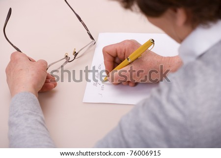 elderly woman writing letter