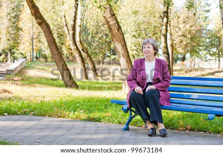elderly women in park - stock photo