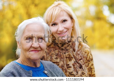 Elderly women with daughter in a garden