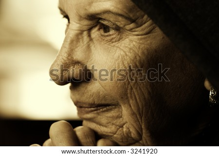 eldery woman (special sepia toned photo f/x, focus point on eye)