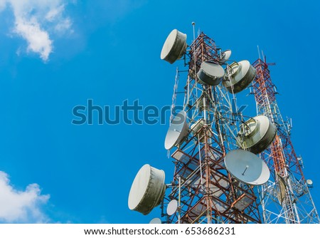 Elecommunication mast TV antennas wireless technology with blue sky