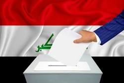 Elections in the country - voting at the ballot box. A man's hand puts his vote into the ballot box. Flag Iraq on background.