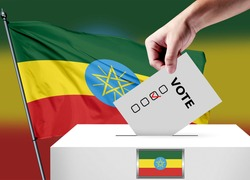 Elections in the Ethiopia. The hand that puts the game in the ballot box. Ethiopia flags in the background. Country flag election.