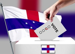 Elections in the Netherlands Antilles. The hand that puts the game in the ballot box. Netherlands Antilles flags in the background. Country flag election.