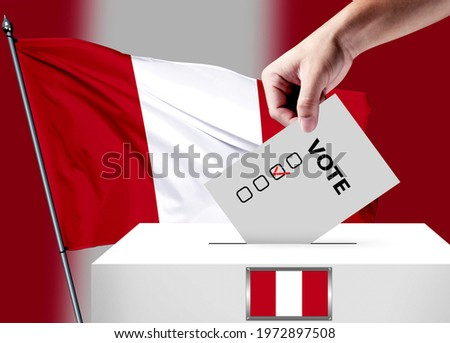 Elections in the Peru. The hand that puts the game in the ballot box. Peru flags in the background. Country flag election.