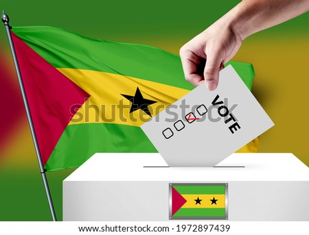 Elections in the Sao Tome and Principe. The hand that puts the game in the ballot box. Sao Tome and Principe flags in the background. Country flag election. ストックフォト ©